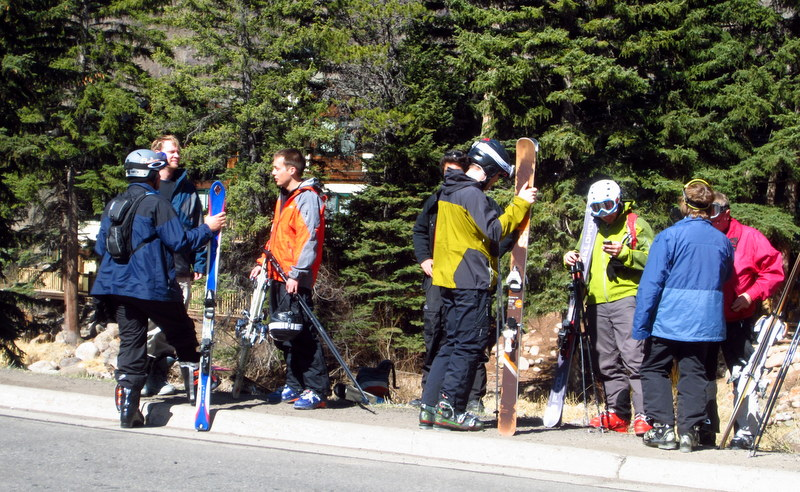 A group of skiers waiting to be taken to the pistes