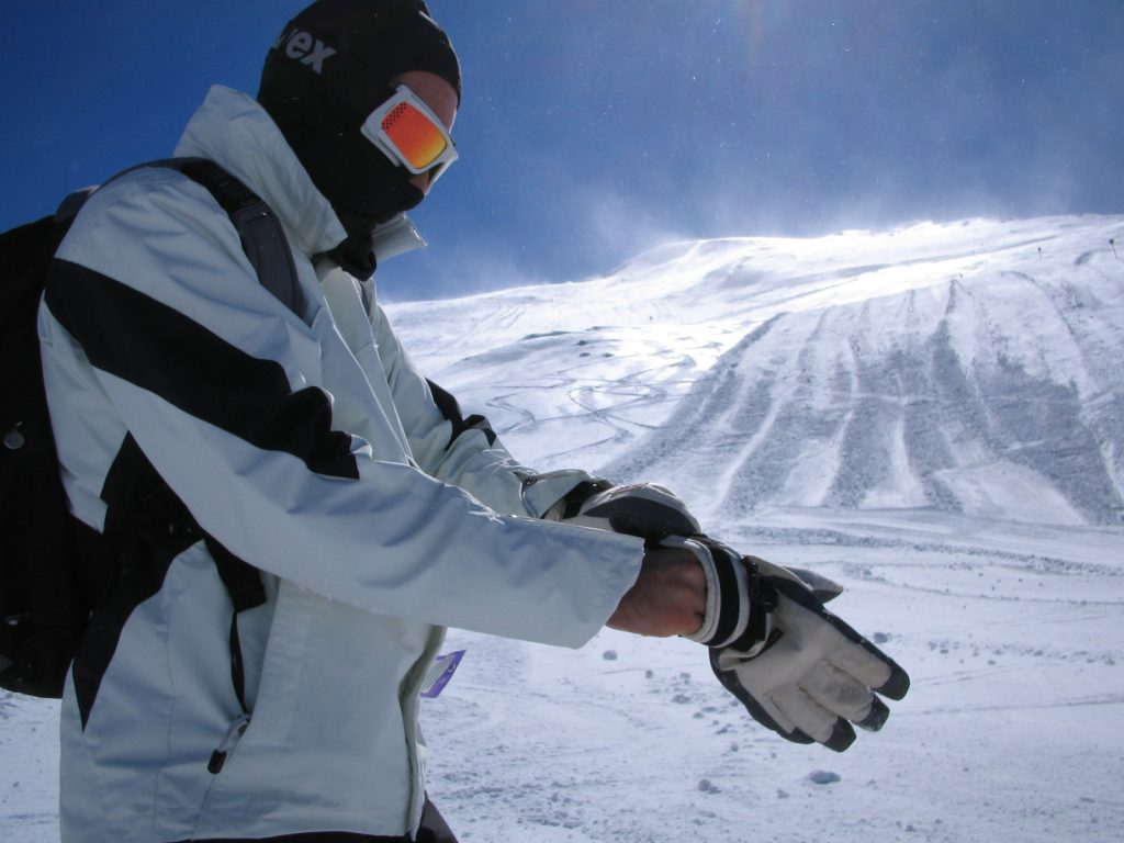 Skier Putting Gloves On